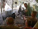 GI in military base watching DVD movies