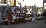 "banner reads ""RESIST STATE BRUTALITY: FREE THE HUNGER STRIKERS"""