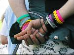 Coloured charity wristbands worn by reveller