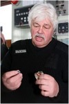 Paul Watson Holding Bullet And Bent Badge