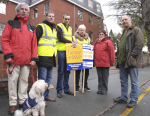 Six striking workers and a dog
