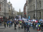 View of part of de demo marching down Whitehall