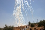Tear gas fired from a vehicle mounted launcher in Bil'in