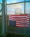 'Thank You Bradley Manning' flag on the perimeter fence at NSA Menwith Hill