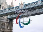 Climate activists scale Tower Bridge & drop banner.
