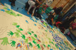 2012: children working on Hands Up for Peace map of the world