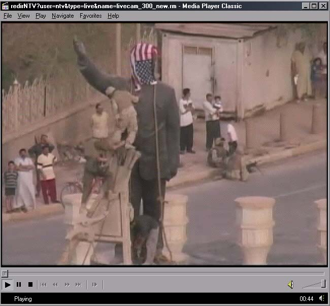 US Army puts it's flag on statue of Saddam