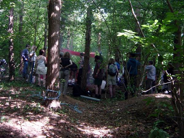 Visitors at the newly established camp in the threatened woods