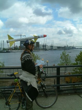 One cyclist makes his point outside ExCel while pondering his next move