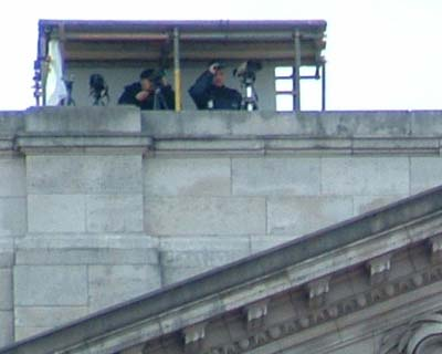 One of several teams US? snipers atop the palace check out the growing crowd bel
