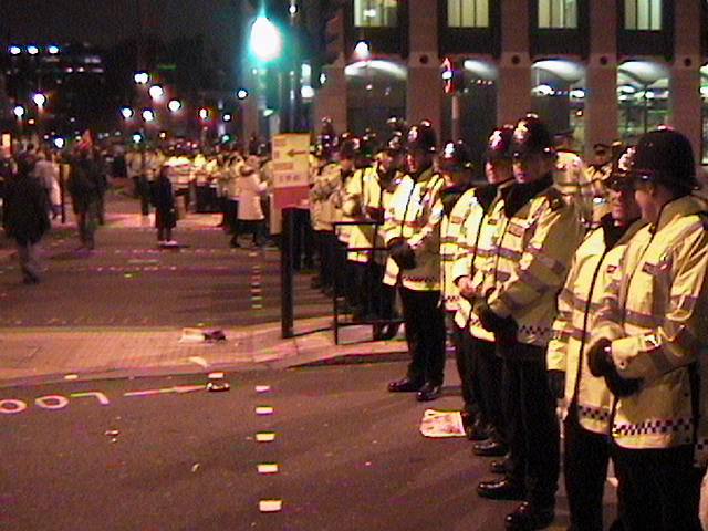 Police lineup greets protesters coming off Westminster Bridge