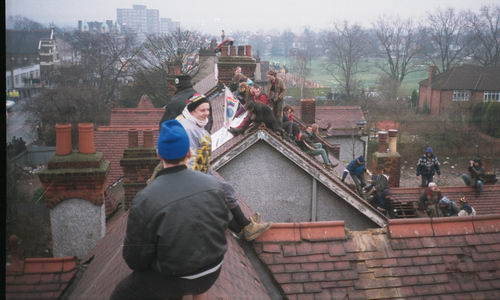 A party atmosphere on the roofs amongst protesters and journalists