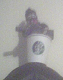 Doll Falling Into Faulty Cup