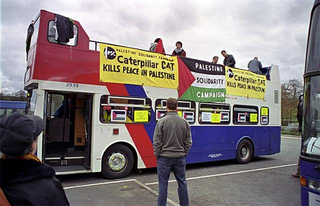 the open-top double-decker bus lead the protest motorcade
