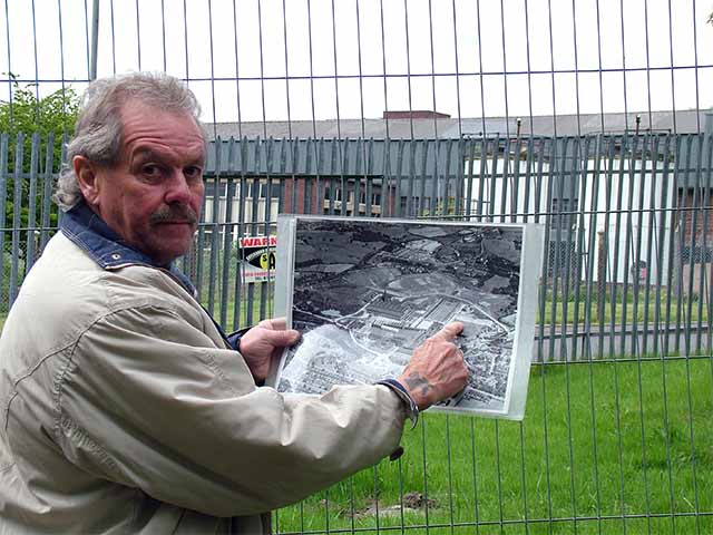 Bryan Sutcliffe points to where he was exposed to asbestos contaminated soil