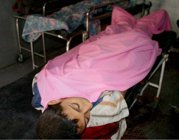 An injured child lies in hospital after a US airstrike