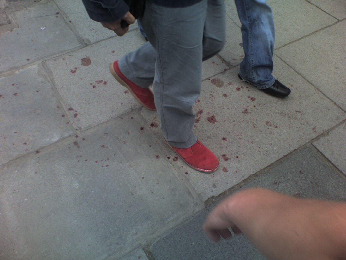 Blood, i assume, on the pavement. 2:05pm