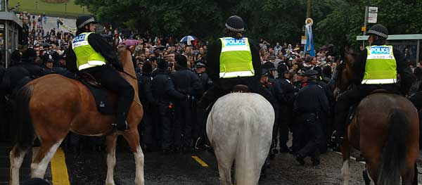 Mounted police push pen up the mound