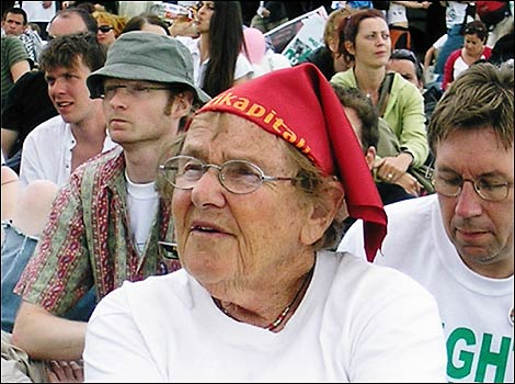 Older woman listens to speakers at the Stop the War Coalition / CND stage