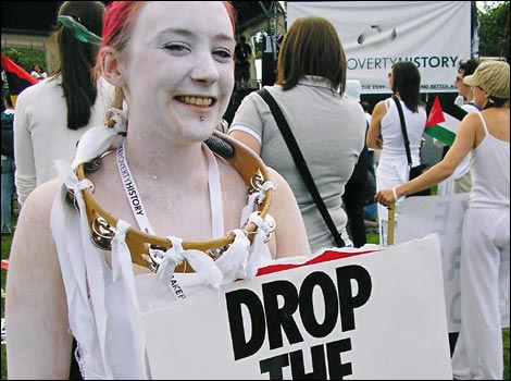 White faced protester calling on G8 leaders to 'Drop the Debt'
