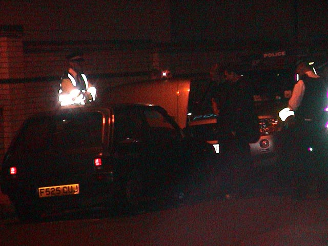 Police inspect car at convergence space Tuesday night