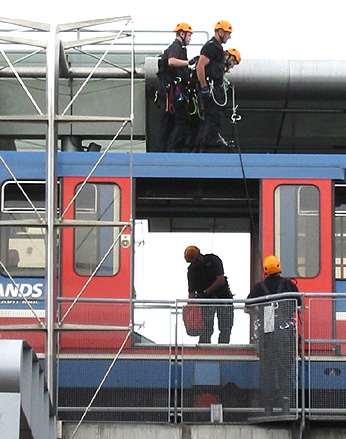 climbers on the DLR approaching protestor