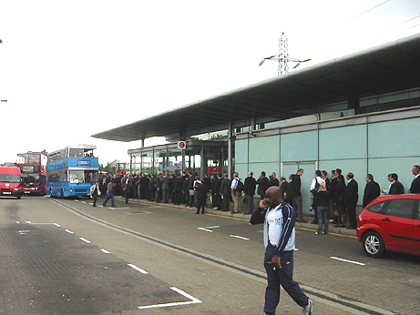 scores of arms fair delegates waiting for replacement buses