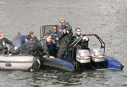Defence Police + Surveillance Cameraman In Boats