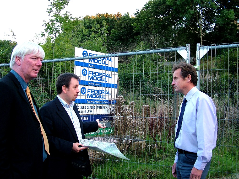Chris Davies MEP (right) and Paul Rowen MP (left) view destroyed woodland