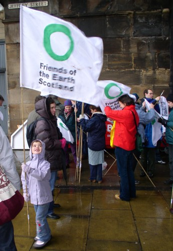 Friends of the Earth were present too. Kid plays with flag.