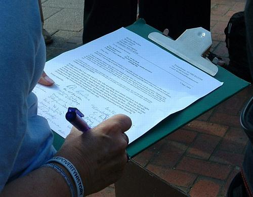 Supporters sign the letter of protest