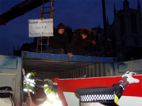 climbers watch banksy artwork being carelessly handled
