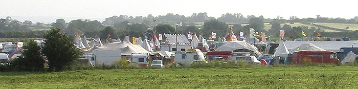 closer view - wind gennies, solar panels and tipis