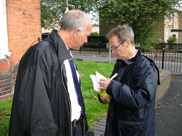 high court bailiff consults with Mr Fletcher from Birmingham City Council