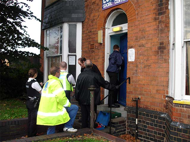 bailiffs attempt to get past barricaded front door