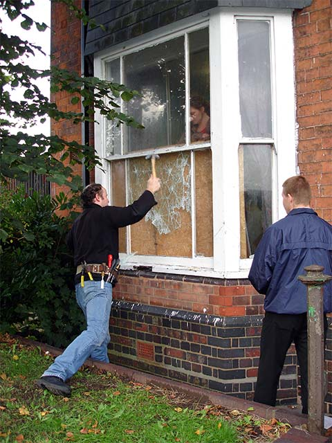 Demented locksmith smashes front window and cuts himself