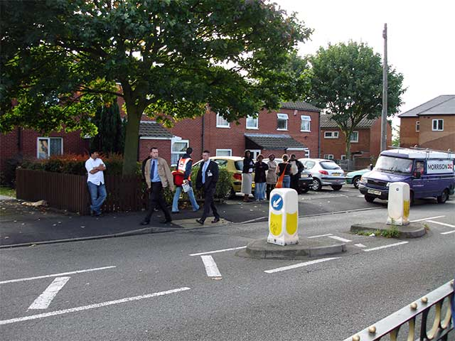 locals look on in disbelief as their council carries out a violent eviction