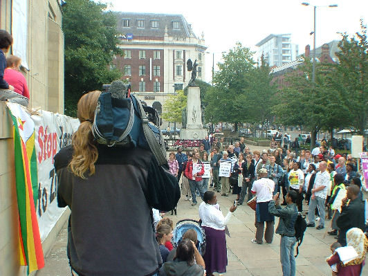 Local news crews cover the demo