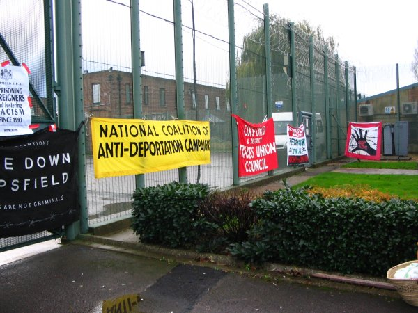 banners on the razorwire fence
