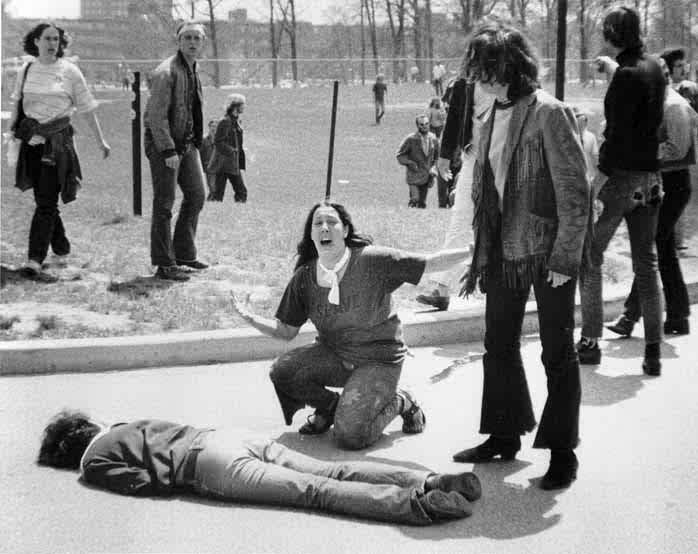Mary Ann Vecchio gestures and screams as she kneels by the body of a student...