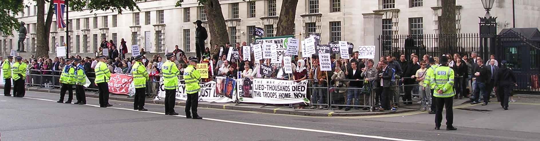 Opposite Downing Street left.