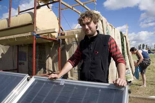 Mark with the soon-to-be-completed solar hot showers.