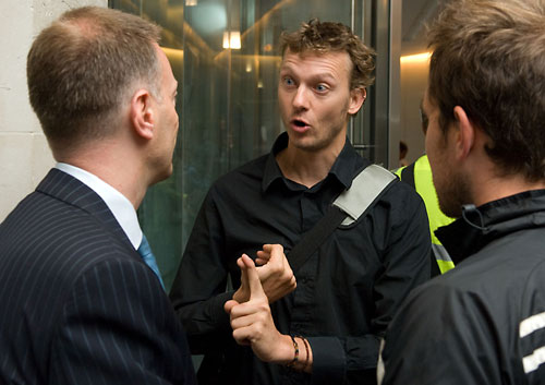 Protesters explain their position to director James Murray (3)