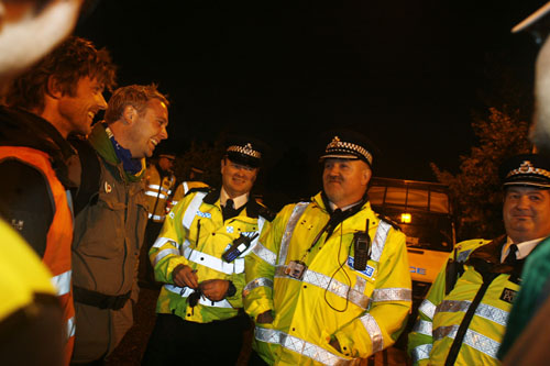 On the car park - night time. Chief of police spreading dis-information