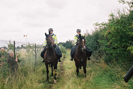 After these 2 horse riders tried to storm us - we waved our arms about to hold