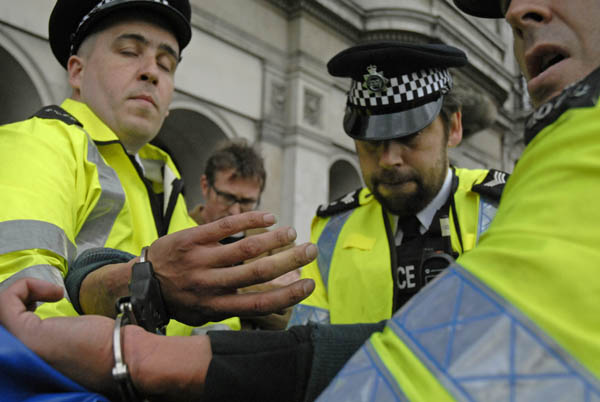 Police arrest protester who appeared to have done nothing illegal