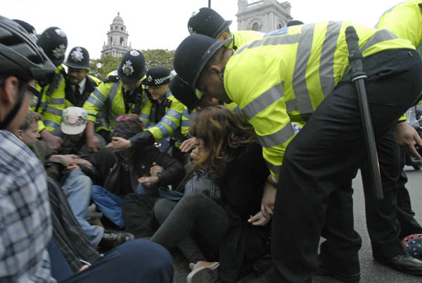 Sit down protest moved by police