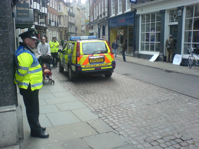 Police help draw attention to the action...