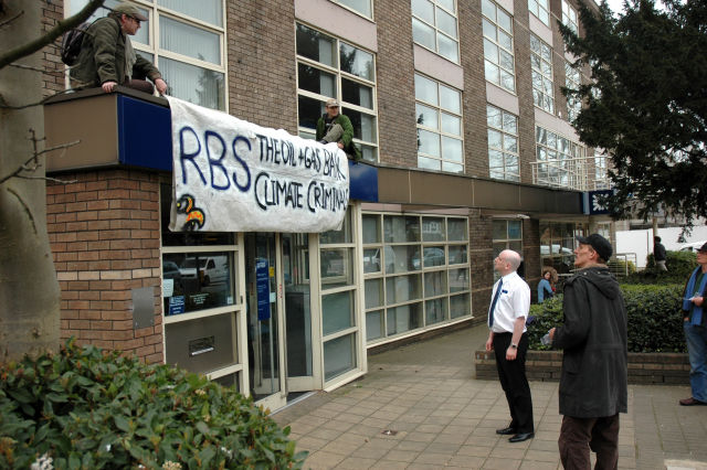 Others handed out leaflets. Here the RBS manager admires the slogan.