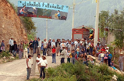 The villagers gather to welcome the activists arriving for the Encuentro.